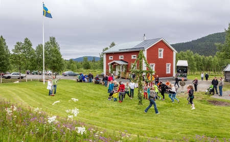 Locals are celebrating midsummer in a small village on its community centre lawnLappland, Kittelfjaell, Sweden  21 June 2013 Stock Photo - 27028074