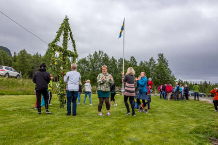 Locals are celebrating midsummer in a small village on its community centre lawnLappland, Kittelfjaell, Sweden  21 June 2013