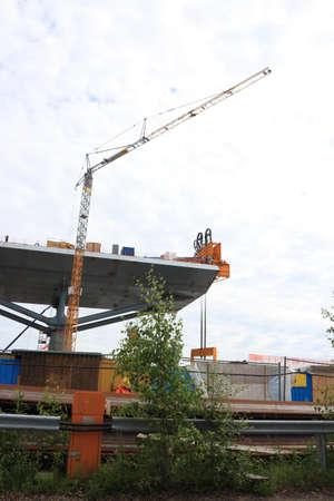 financed: Crane helping in bridge lift Public project  tax financed