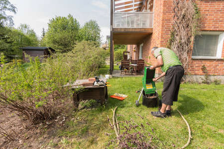 shipper: Adult man working in the garden with a wood shipper Stock Photo
