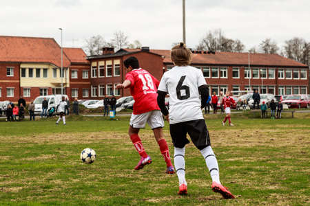 tog: Laxaa, Sweden - May 1, 2015: Young boys from two different football clubs, team erebro and team Laxaa, playing soccer in a friendly match for training purpose Editorial
