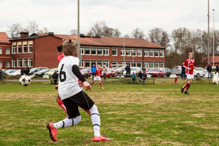 industrious: Laxaa, Sweden - May 1, 2015: Young boys from two different football clubs, team erebro and team Laxaa, playing soccer in a friendly match for training purpose Editorial