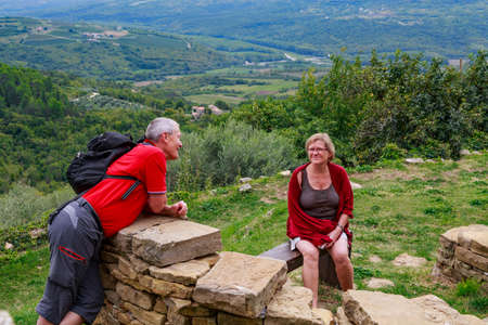 tog: Adult couple exploring a mountain village Stock Photo