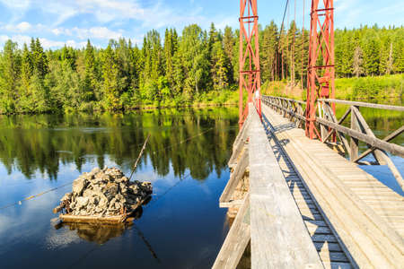 forested: The river Indalsaelven flows trough deep forested valeys. This bridge orginates from 1914 and was built to connect two villages