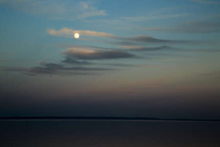 mirk: View over a lake surface in nightfall. Lake V�ttern Stock Photo