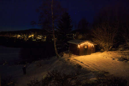 mirk: Christmas decorated tool shed in a wintry nightfall