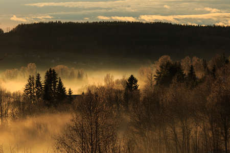 mirk: fog over the valley lit by the winter sunset Stock Photo