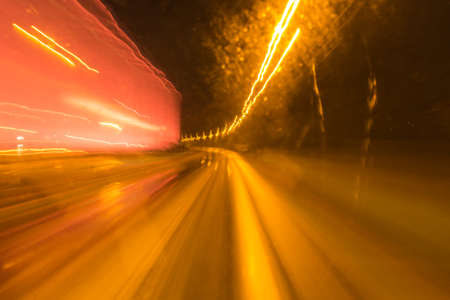 light traces: View from double-decker bus showing light traces, rays of light and patterns from traffic in the darkness of night Stock Photo
