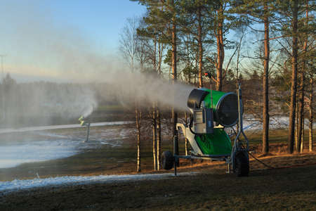 recreational area: Snow making in a recreational area surounded by forest near �rebro