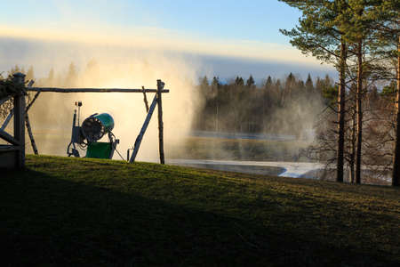recreational area: Snow making in a recreational area surounded by forest near Örebro Stock Photo