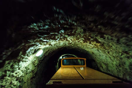 mirk: Postojnska, Slovenia – September 24, 2015: Train for transportation of visitors in a tunnel into Europes largest cave system