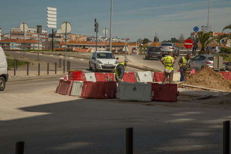 tog: Setubal, Portugal - April 8 2016: Workers working with a roundabout in the afternoon