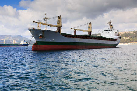 attain: Ship anchord near the city of Setubal on the river Sado Stock Photo