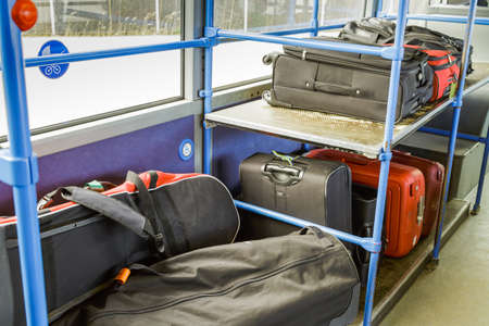 trait: ordinary luggage and golf luggege on its way to the airport Stock Photo