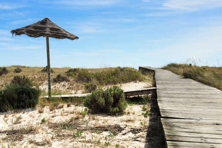 placid water: Dunes of the peninsula where the resort Troia is located
