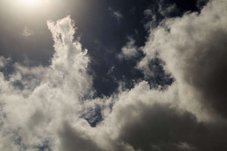 trait: dramatic clouds lit by the sun Stock Photo