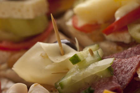 Closeup of a tasty salami and cheese appetizer on a buffet display with shallow dof