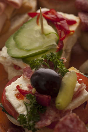 Delicious feta starter garnished with a black olive, gherkin, pimento and herbs