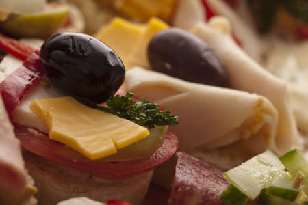Closeup of ham and salami appetizers on a buffet at a celebration or party