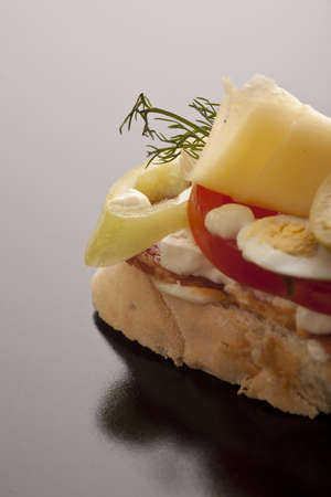 Dellicious open sandwich with cheese, egg and salami on fresh white bread Stock Photo