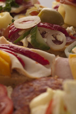 Display of tasty appetizers on a catered buffet with selective focus to the top of the frame