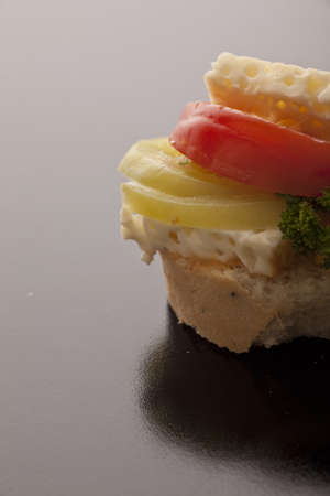 Closeup of feta cheese, onion and tomato on white crusty bread with copyspace Stock Photo