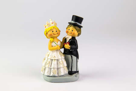 Figures of the bride and groom on a white background