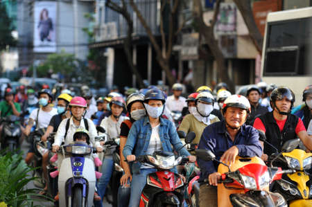HO CHI MINH, VIETNAM - OCTOBER 29, 2014: People go to work by motorcycles