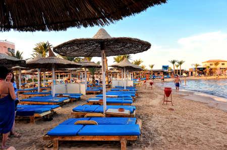 HURGHADA, EGYPT - OCTOBER 14, 2013: Sandy beach full of people is on the Red Sea coastline. Luxury resort hotel on Red Sea beach the Hurghada resort in Egypt. Editorial