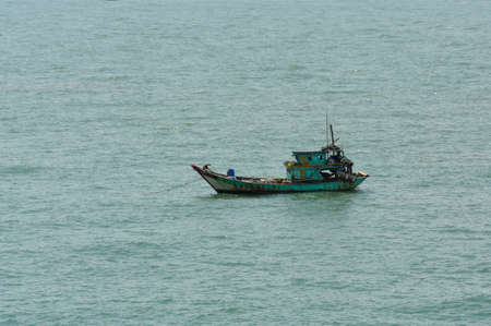 Fisherman's boat at anchored in the bay at Vung Tau, Vietnam.