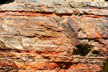 Ancient wall made of large stones of iron ore bonded by sand. Stock fotó - 128602048