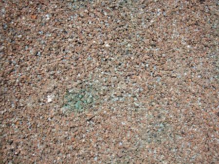 Granite crumb in the wall. Granite stone, wall of granite. Background small granite chips. Stockfoto