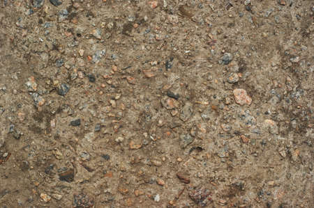 Yellow cobblestone gravel stones boulders pebbles texture background close-up. Material for repair and road construction