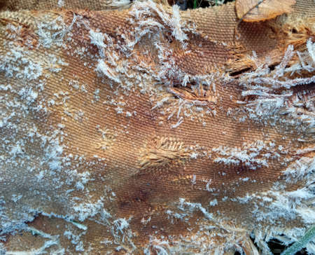 Close-up of hoarfrost on natural burlap sacking. Background texture using burlap material.