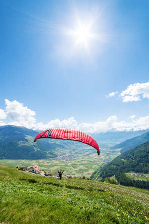 Paraglider in the mountains with blue sky
