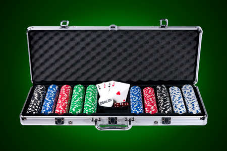 Poker case with chips and cards with path on white background photo