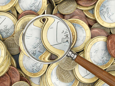 Euro coins with magnifying glass analyzing Reklamní fotografie