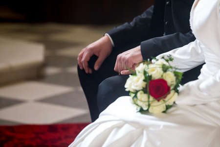 Couple on marriage holding hands in church