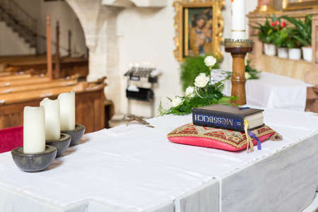 Altar in a church with book and candles