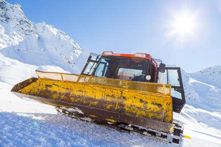 snow grooming machine: Snowplow in the mountains prepairing piste