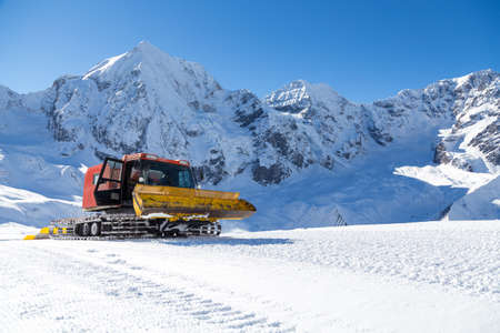 snow grooming machine: Snowplow in the mountains prepairing piste