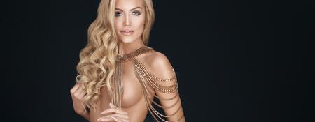 sexy nude women: Sensual blonde beautiful lady posing . Woman with ideal body. Studio shot.