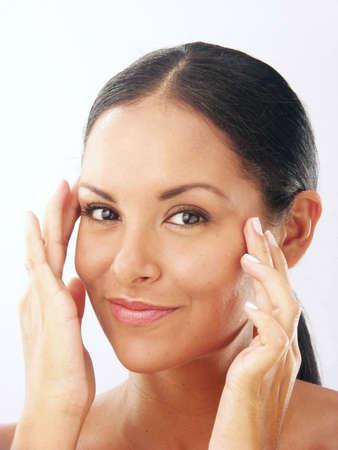 Beautiful young latin woman on white background
