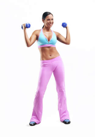 Young woman doing fitness exercise with hand weights on white background photo
