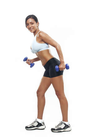 Young woman doing fitness exercise with hand weights photo
