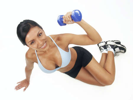 Young woman doing fitness exercise with hand weight Stock Photo