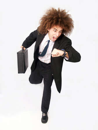 late 20s: Businessman with afro hairstyle running while looking at his watch on white background
