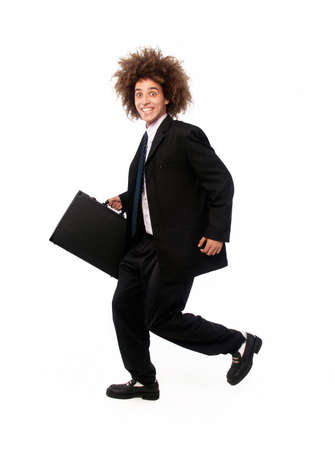 Businessman with afro hairstyle holding a suitcase on white background photo
