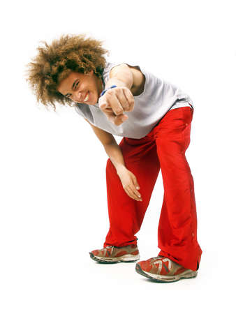 Young man with afro hairstyle pointing at you on white background photo