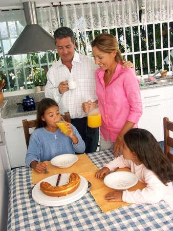 Hispanic family having breakfast in a kitchen Stock Photo - 22413320